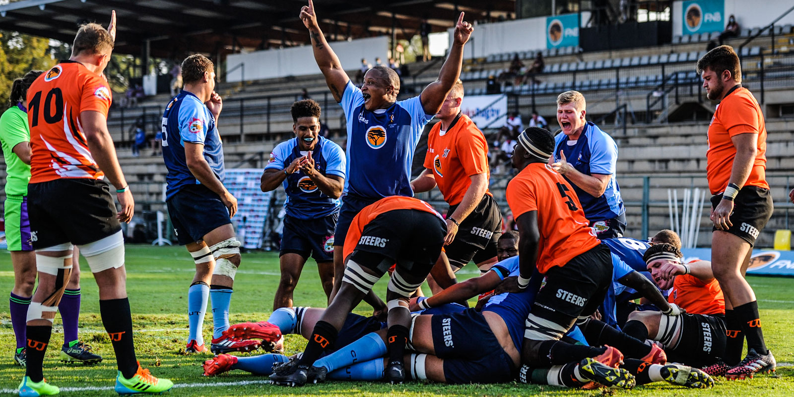 CUT celebrate as Johannes Terblanche goes over for the first try of the match against UJ.